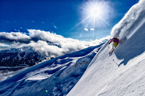 bluebird powder day heliskiing in the alpine. Photo - Grant Gunderson