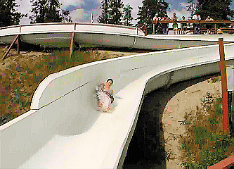 """Laugh in the face of warm summer days with the North-most waterslide"" Photo - watsonlake.ca"